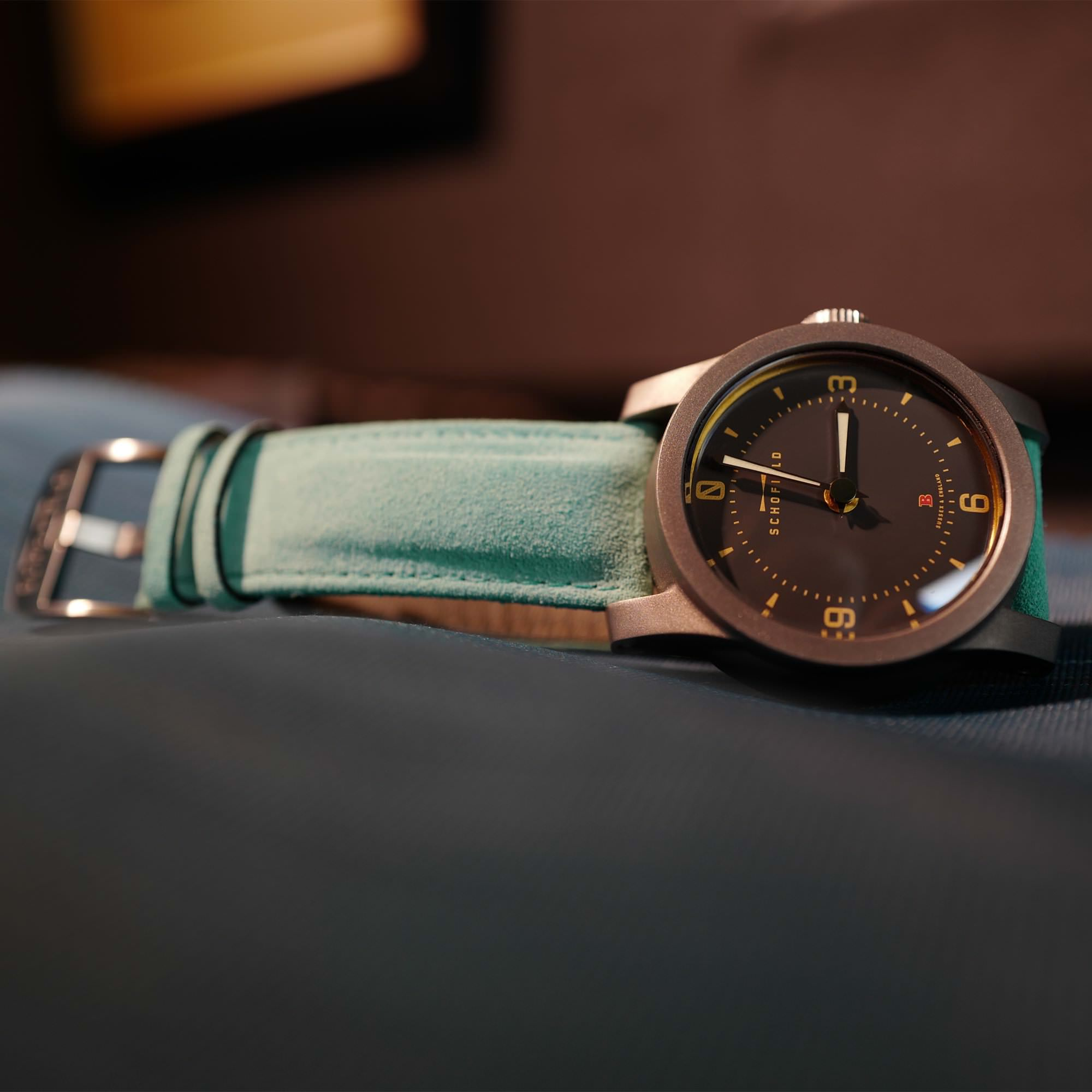 Schofield Beater watch on turquoise suede strap
