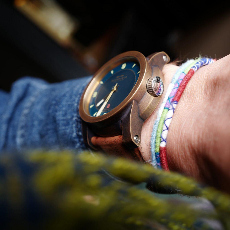 Bronze beater watch on wrist