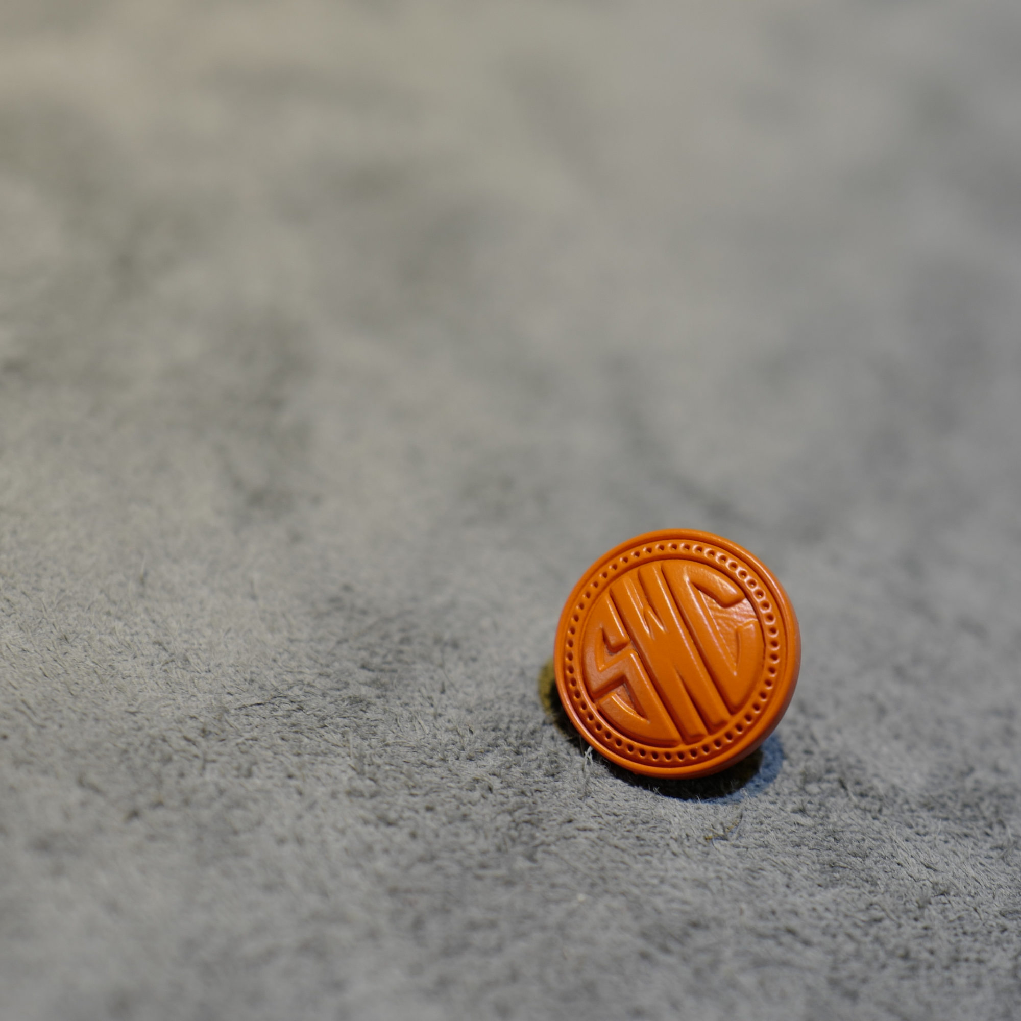Orange coated ceramic pin