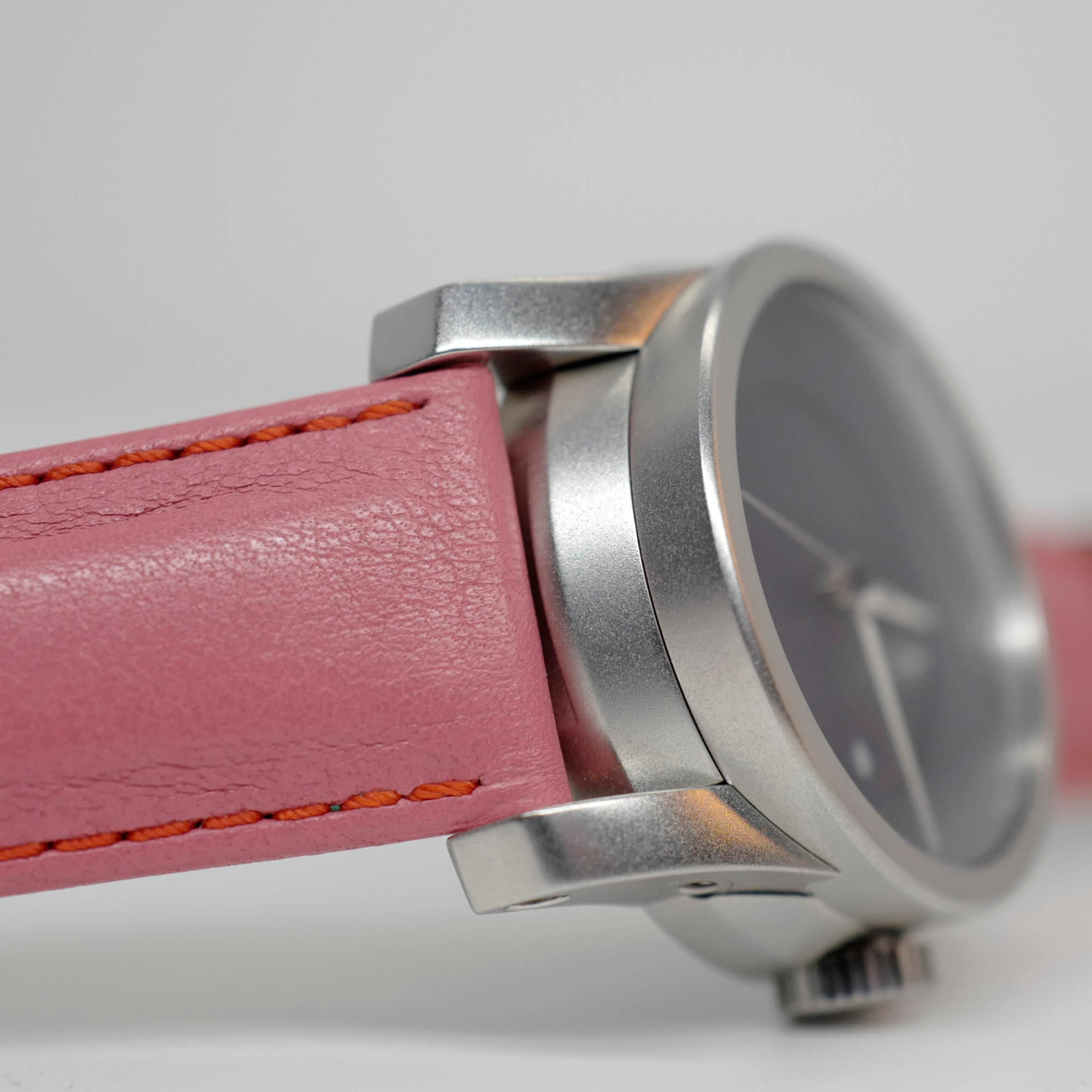 Pink Salmon Strap on blue watch